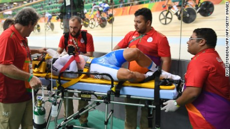 South Korea's Park Sanghoon is stretchered off after crashing during the Men's Omnium Points race track cycling event at the Velodrome during the Rio 2016 Olympic Games in Rio de Janeiro on August 15, 2016. / AFP / Eric FEFERBERG        (Photo credit should read ERIC FEFERBERG/AFP/Getty Images)