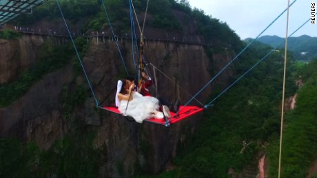 title: Chinese couple holds unforgettable wedding ceremony underneath glass bridge  duration: 00:01:40  site: Reuters  author: null  published: Thu Jan 01 1970 08:00:00 GMT+0800 (China Standard Time)  intervention: no  description: null