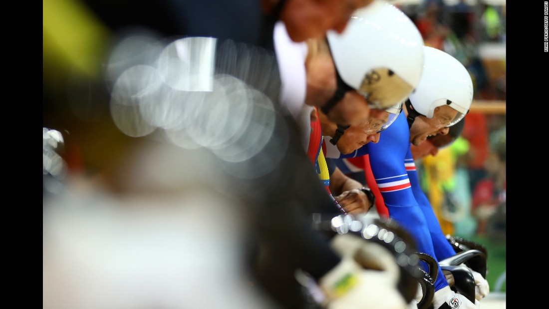 Track cyclists prepare to compete in the first round of the keirin.