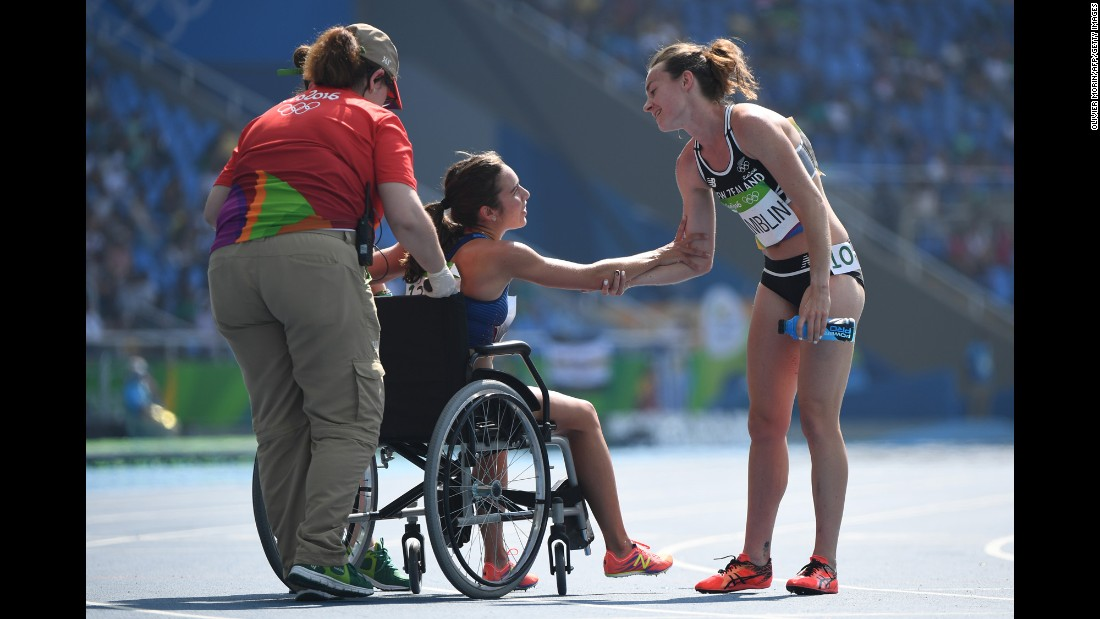 "Abbey D'Agostino of the United States leaves the track on a wheelchair after twisting her ankle in the 5000-meter semifinal on Tuesday, August 16. D'Agostino and New Zealand's Nikki Hamblin, right, <a href=""http://www.nbcolympics.com/video/us-runner-finishes-race-after-falling-hard"" target=""_blank"">collided during the race</a> but helped each other up and managed to make it to the finish line."