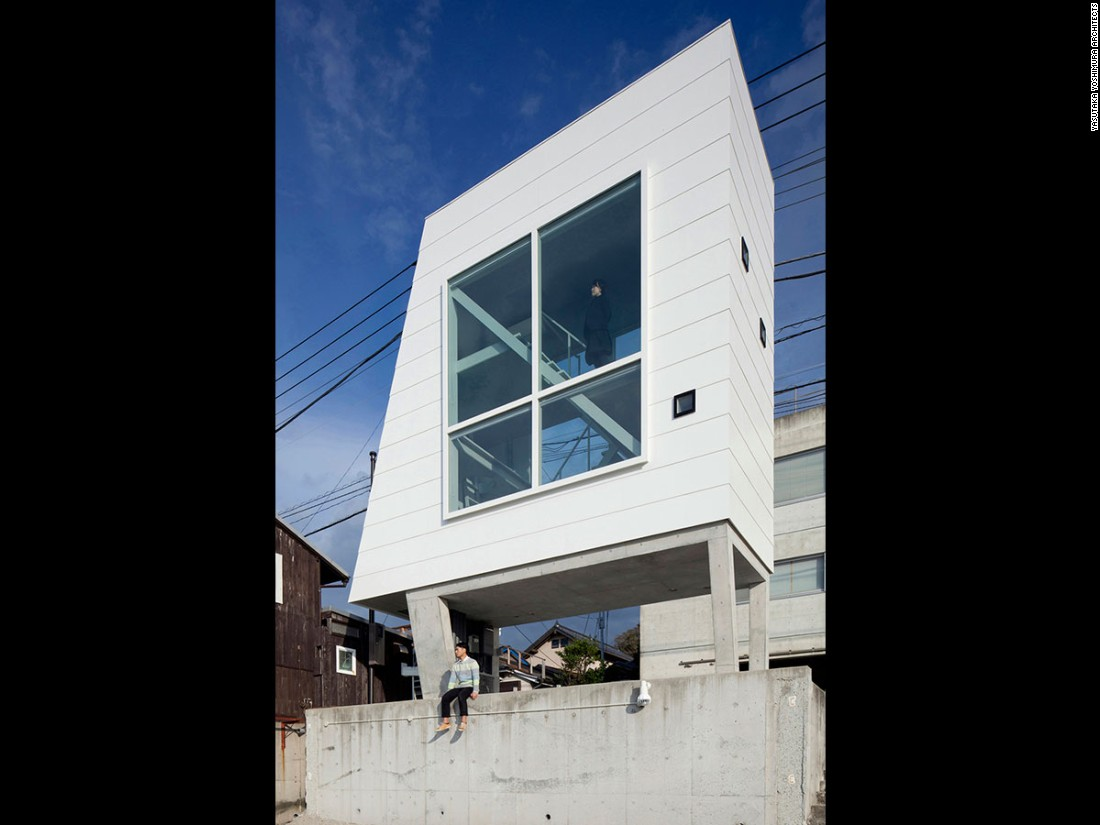 At just 258 square feet, Window House is appropriately named -- two huge windows showcase the sea on one side and the mountain on the other.