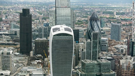 The City of London financial district skyline includes a number of unusual buildings, including the rounded Gherkin (R) and the  'Walkie Talkie' (C front), the winner of the 2015 Carbuncle Cup.