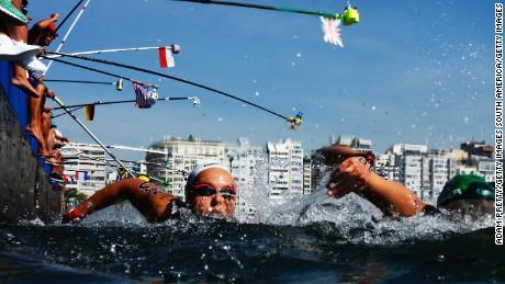 Aurelie Muller of France takes on refreshments during the Women's 10km Marathon Swim.