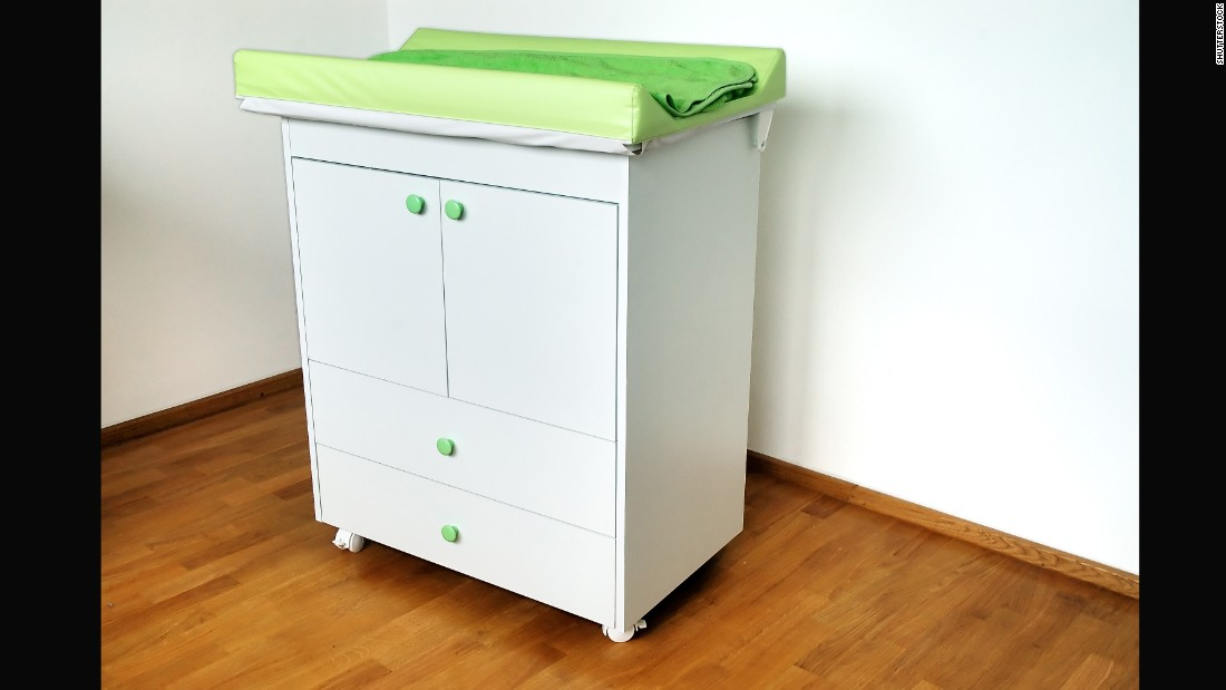 """Changing tables, like all large furniture items, should be <a href=""""https://www.healthychildren.org/English/safety-prevention/at-home/Pages/Preventing-Furniture-and-TV-Tip-Overs.aspx"""" target=""""_blank"""">anchored to walls to prevent tipping</a>. The American Academy of Pediatrics urges parents to <a href=""""https://www.healthychildren.org/English/safety-prevention/at-home/Pages/Changing-Table-Safety.aspx"""" target=""""_blank"""">never step away from a baby on a changing table</a>, even if the child is buckled or seems too young to roll."""