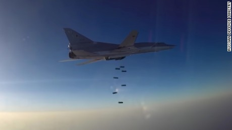 A screengrab of footage released by the Russian Defense Ministry shows a Russian warplane, launched from Iran, conducting an airstrike over Syria.