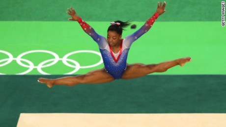 U.S. gymnast Simone Biles won a record-tying four gold medals and one bronze as she dazzled the crowd with a mix of elegance and athleticism rarely seen in the sport.