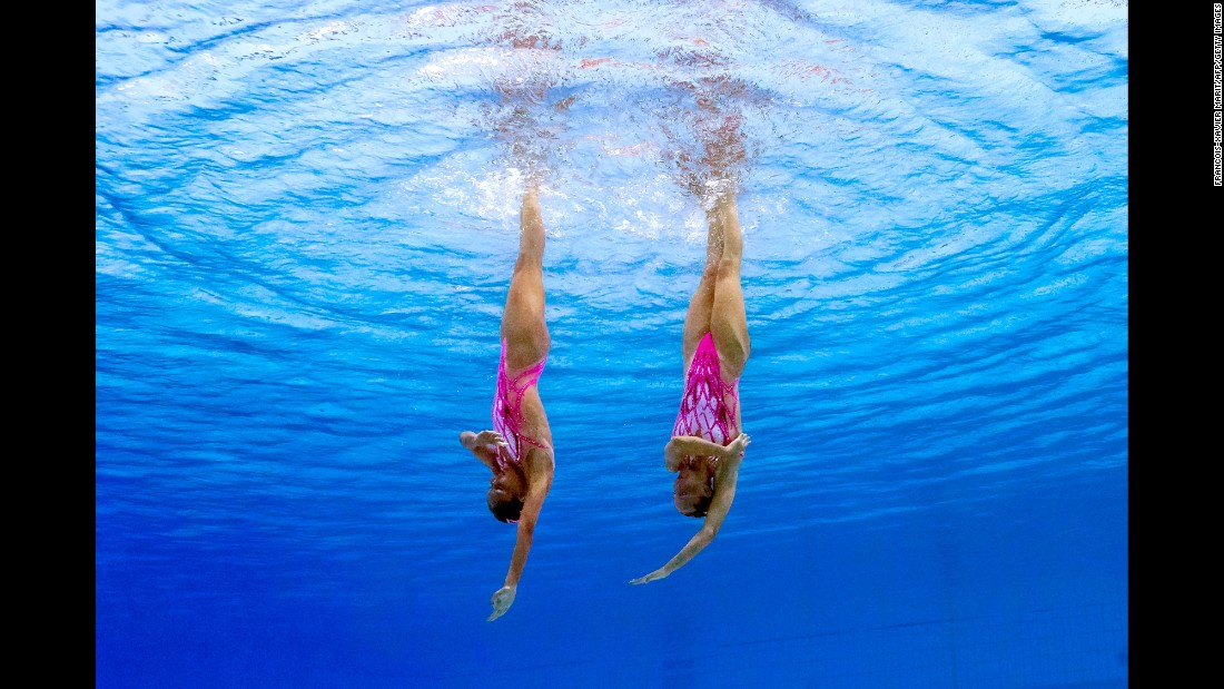 Italy's Costanza Ferro and Linda Cerruti perform their technical routine during synchronized swimming.