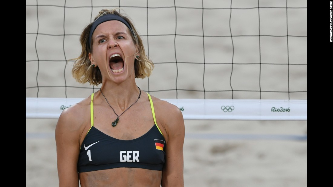 Germany's Laura Ludwig reacts during a semifinal win in beach volleyball.