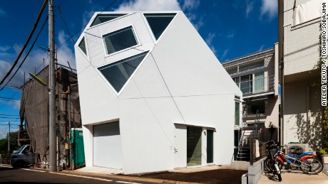 This Tokyo home, designed by Atelier Tekuto, takes the shape of a polyhedron in order to provide an enormous skylight above the living room.