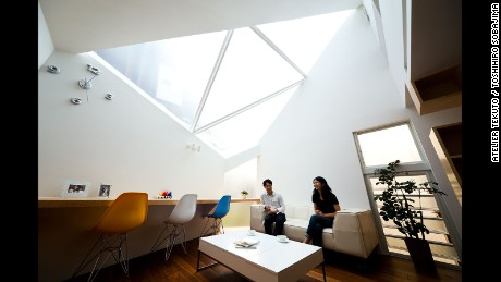 """Aptly named """"Framing the Sky,"""" this Atelier Tekuto home was built on a polygon-shaped site. The architects focused on the relationship between nature and people, by incorporating a large skylight to make the home feel like it was extending upwards into the sky."""