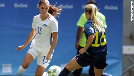 United States' Alex Morgan controls the ball challenged by Sweden's Elin Rubensson during a quater-finals match of the women's Olympic football tournament between the United States and Sweden in Brasilia Friday Aug. 12, 2016.(AP Photo/Eraldo Peres)