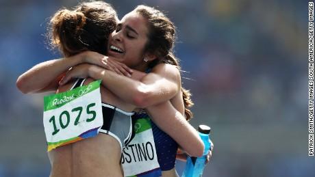 D'Agostino and Hamblin hug after their 5,000m race.