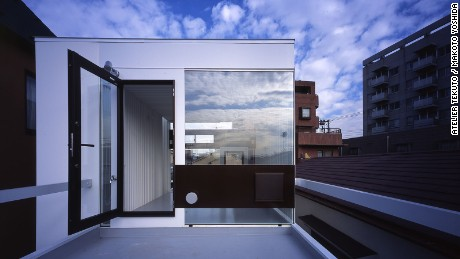 An industrial-style home designed by Atelier Tekuto, Wafers makes use of reinforced concrete, steel and highly reflective windows.