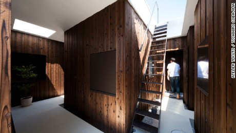Using natural materials such as cedar wood and terrazzo floors, Atelier Tekuto created a nature-inspired abode for a Japanese family.