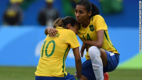 Brazil's player Bruna (R) comforts teammate Marta after losing to Sweden in their Rio 2016 Olympic Games Women's semi-final football match at the Maracana Stadium in Rio de Janeiro, Brazil, on August 16, 2016.                                   / AFP / VANDERLEI ALMEIDA        (Photo credit should read VANDERLEI ALMEIDA/AFP/Getty Images)