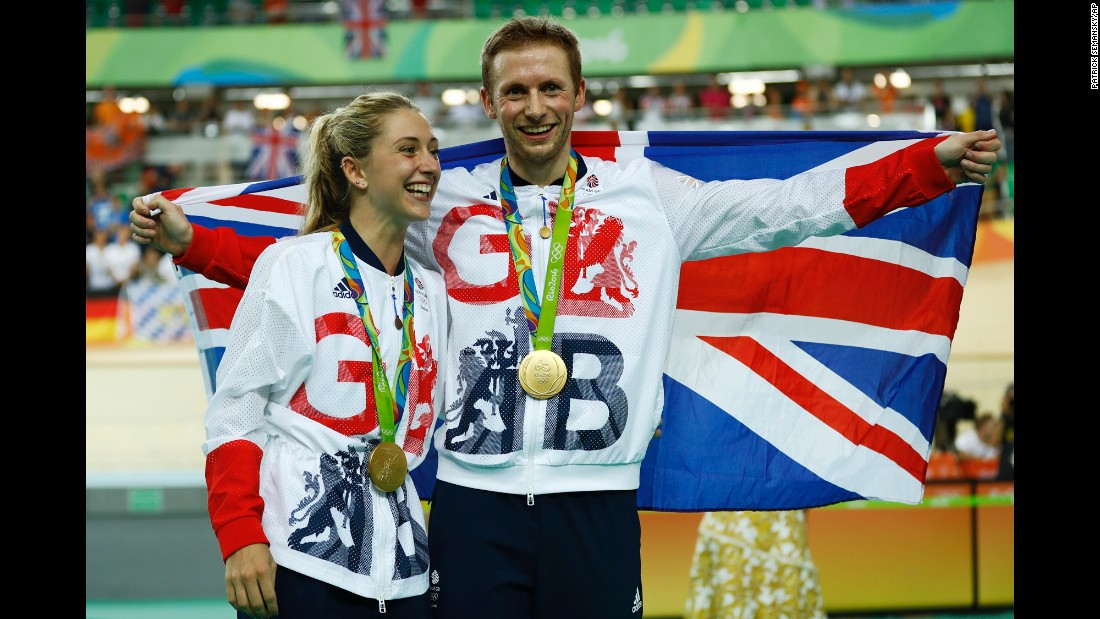 Great Britain's Laura Trott and her fiance, Jason Kenny, pose with their gold medals in track cycling. Kenny won the keirin and Trott won the omnium.