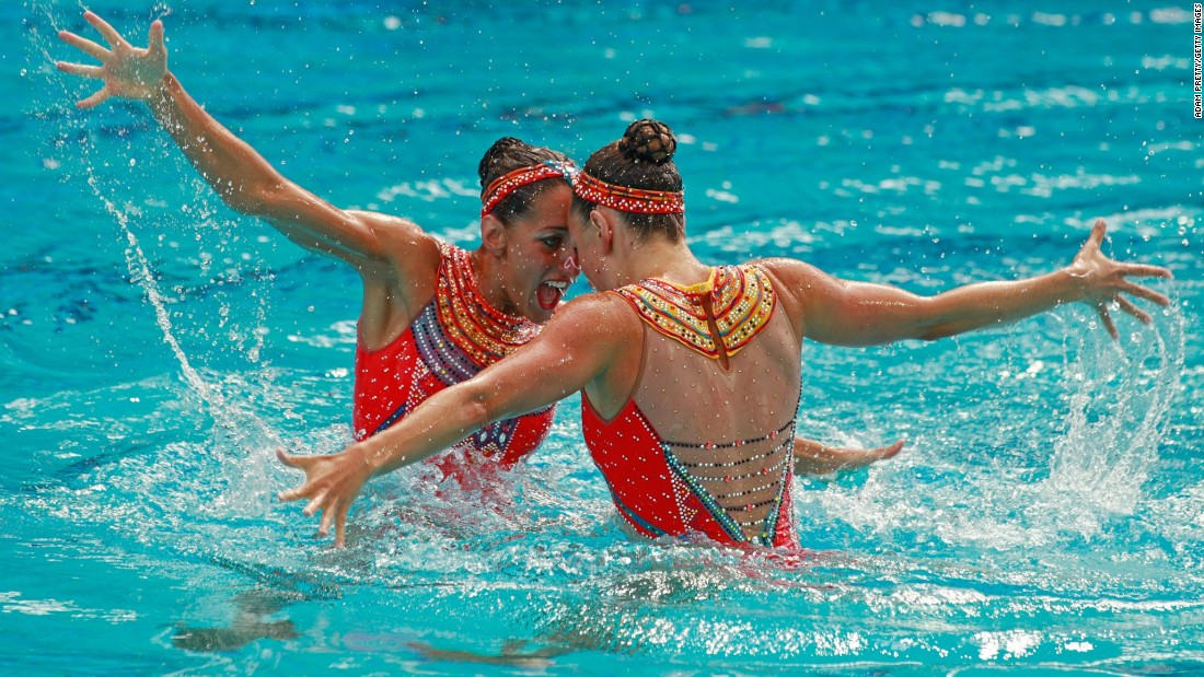 French synchronized swimmers Laura Auge and Margaux Chretien compete in the duets final.