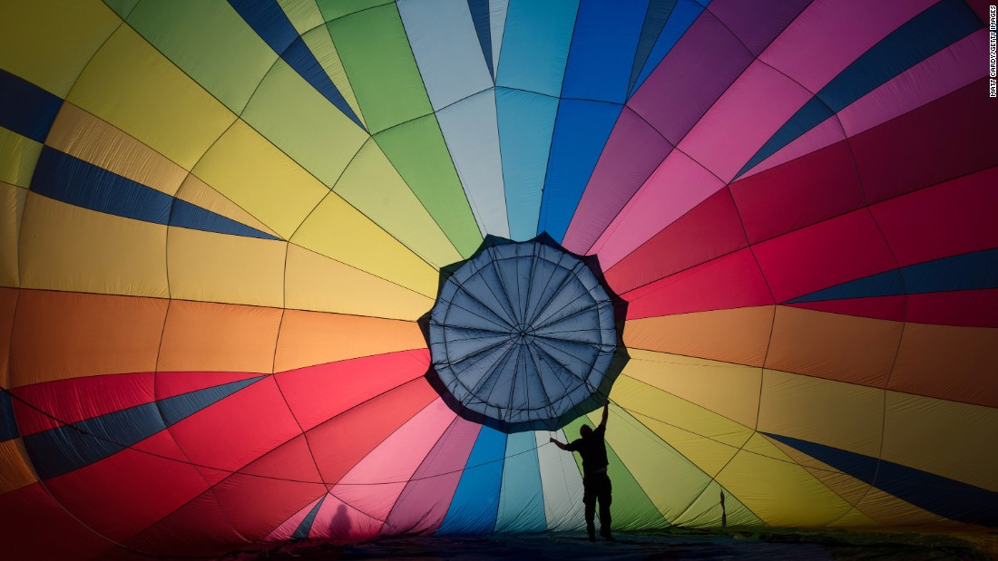 "More than 150 hot air balloons from around the world gathered for the <a href=""http://edition.cnn.com/2016/08/15/travel/bristol-balloon-fiesta-pictures/"">38th annual Bristol International Balloon Fiesta</a> in southwest England. The event attracted about half a million spectators from as far afield as Latvia and Thailand."