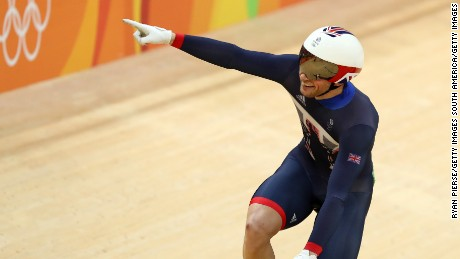 Kenny celebrates after winning the men's keirin final.