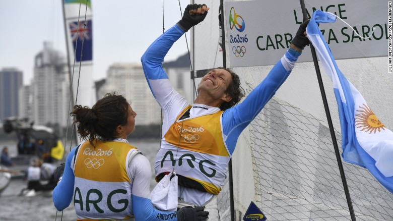 Argentina's Santiago Lange (right) and Cecilia Carranza Saroli celebrate winning sailing gold.