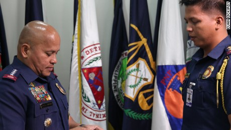 ronald dela rosa speaks to one of his officers in his office at the police headquarters in camp crame, quezon city.
