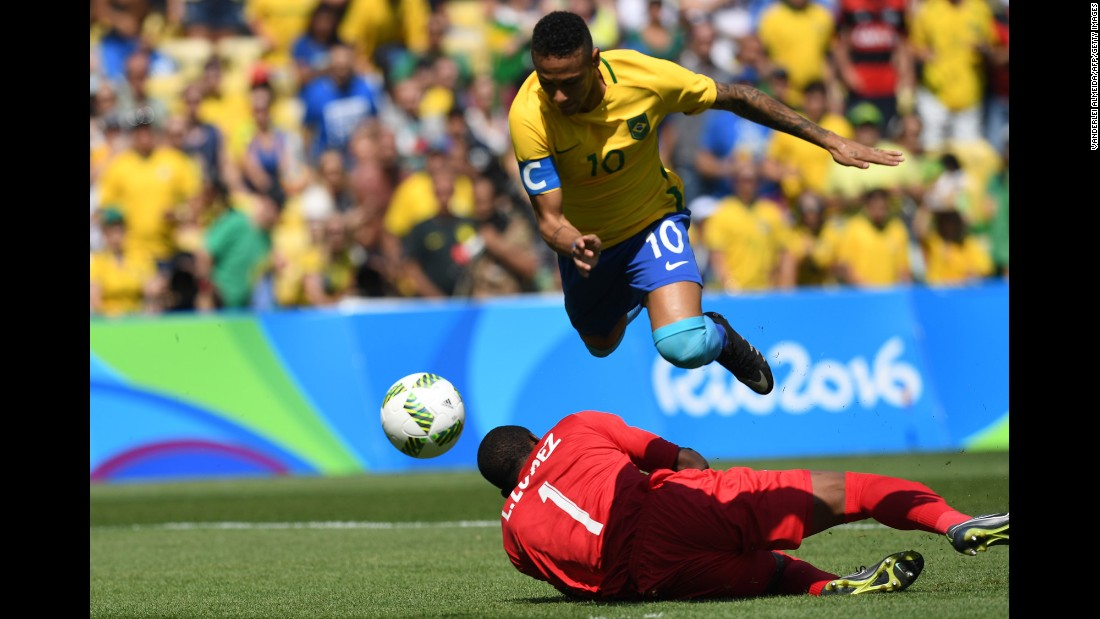"Brazilian soccer star Neymar goes for goal during a semifinal match against Honduras. He scored within the first 15 seconds, and <a href=""http://www.cnn.com/2016/08/17/sport/brazil-beats-honduras-to-set-up-rematch-with-germany-in-olympic-final/index.html"" target=""_blank"">Brazil won 6-0.</a>"