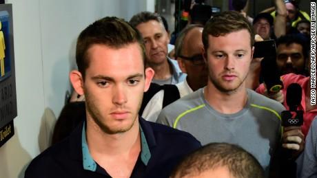 American swimmers Gunnar Bentz (left) and Jack Conger leave the police station at the Rio airport.
