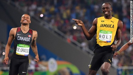 Jamaica's Usain Bolt (C) jokes with Canada's Andre De Grasse (L) after they crossed the finish line in the Men's 200m Semifinal during the athletics event at the Rio 2016 Olympic Games at the Olympic Stadium in Rio de Janeiro on August 17, 2016.   / AFP / OLIVIER MORIN        (Photo credit should read OLIVIER MORIN/AFP/Getty Images)