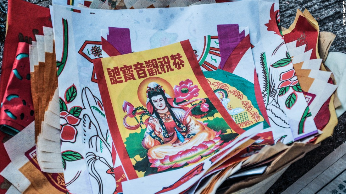 Offerings burned in the street usually include an image of Guan Yin, the Chinese goddess of generosity.