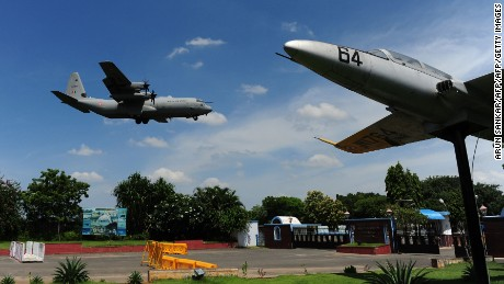 An Indian Air Force Hercules comes in to land in Chennai after a search for the missing plane.