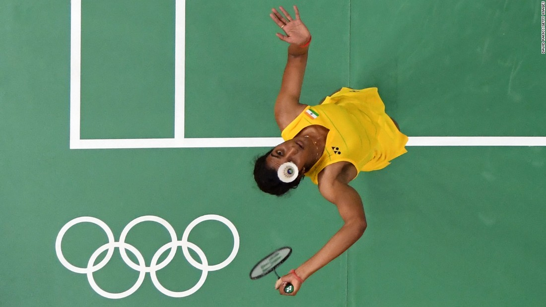 Indian badminton player P. V. Sindhu plays a semifinal match against Japan's Nozomi Okuhara. Sindhu won, and she will face Spain's Carolina Marin in the gold-medal match on Friday.