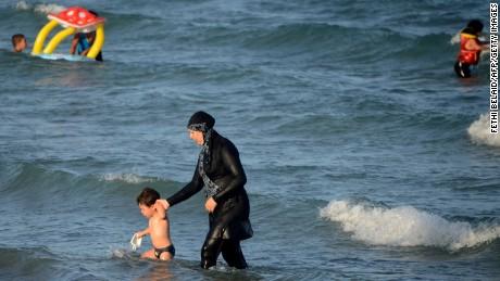 A woman wears a burkini, on a beach near Tunis, Tunisia.