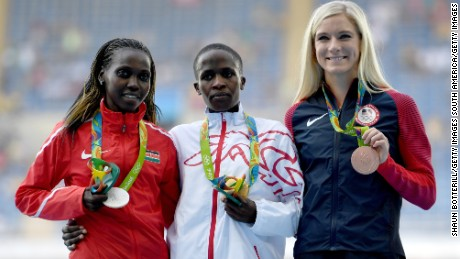 Ruth Jebet (center) of Bahrain poses with her  gold medal.