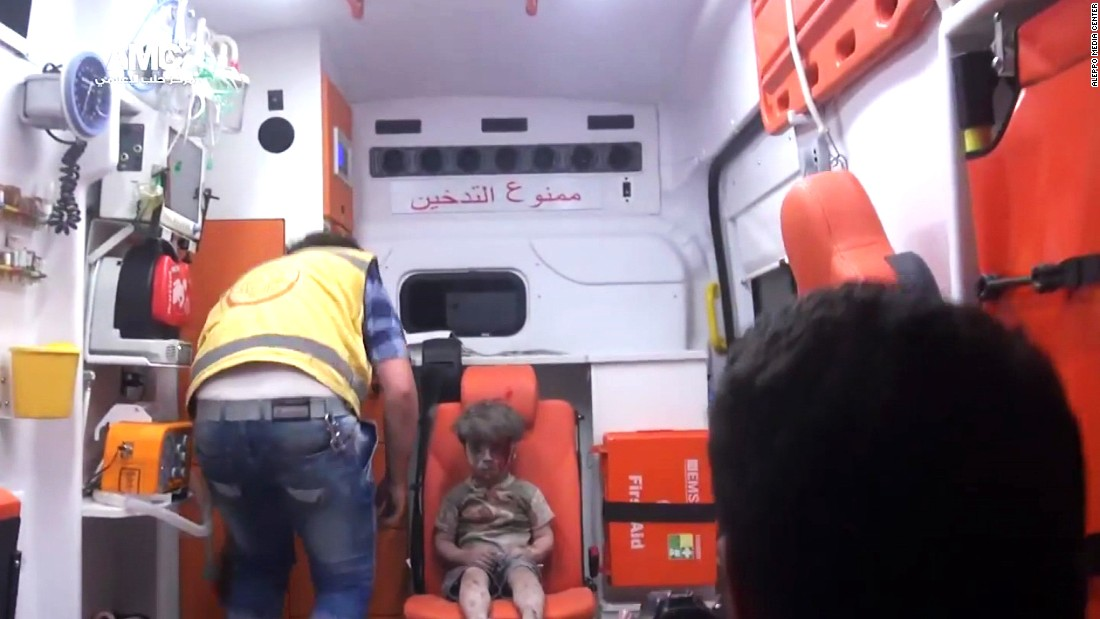 "The bloodied boy sits and waits for medical attention. An Aleppo Media Center activist <a href=""http://www.cnn.com/2016/08/17/world/syria-little-boy-airstrike-victim/index.html"" target=""_blank"">told CNN</a> that Omran did not cry at any point during the rescue and appeared to be in extreme shock."