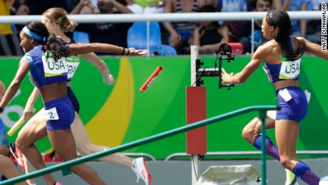 English Gardner and Allyson Felix, right, from the United States, drop the baton in the women's 4x100-meter relay heat.