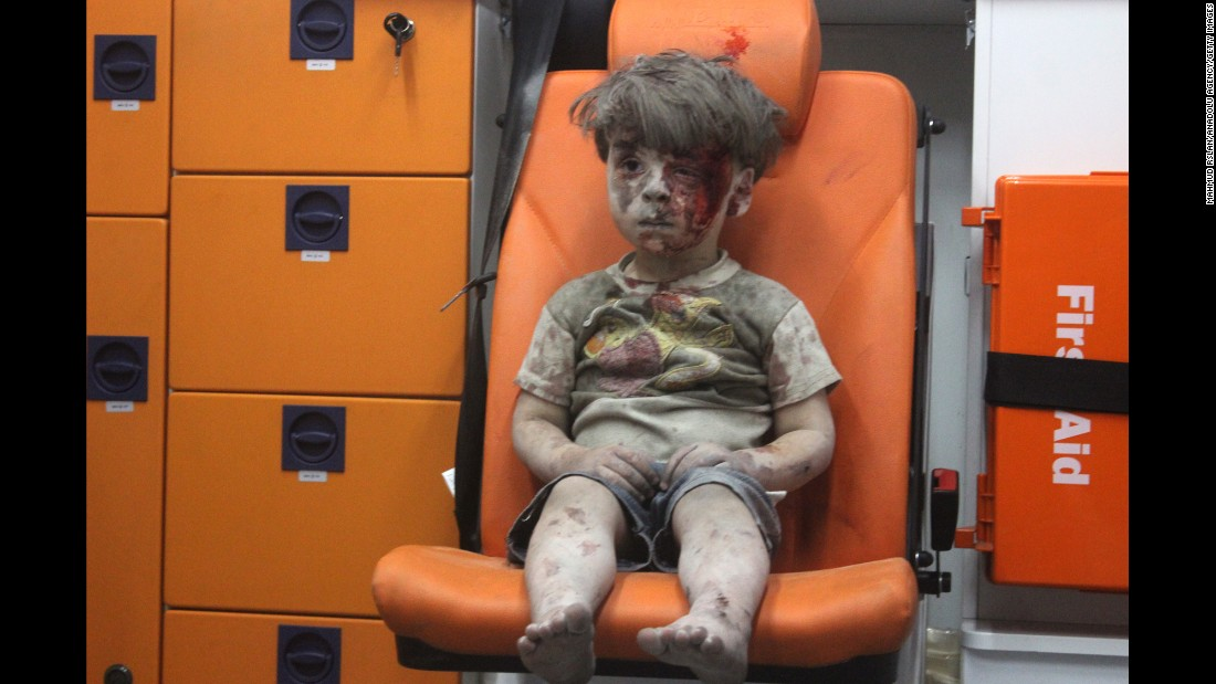 """This still image, taken from a video posted by the Aleppo Media Center, shows a young boy in an ambulance after an airstrike in Aleppo, Syria, on Wednesday, August 17. It took nearly an hour to dig the boy, <a href=""""http://www.cnn.com/2016/08/17/world/syria-little-boy-airstrike-victim/index.html"""" target=""""_blank"""">identified as Omran Daqneesh,</a> out from the rubble, an activist told CNN. The airstrike destroyed his home, where he lived with his parents and two siblings. Director of the Aleppo Media Center Yousef Saddiq said Omran's 10-year-old brother, Ali, <a href=""""http://www.cnn.com/2016/08/20/middleeast/syria-conflict/index.html"""" target=""""_blank"""">died from his injuries</a> on Saturday, August 20."""