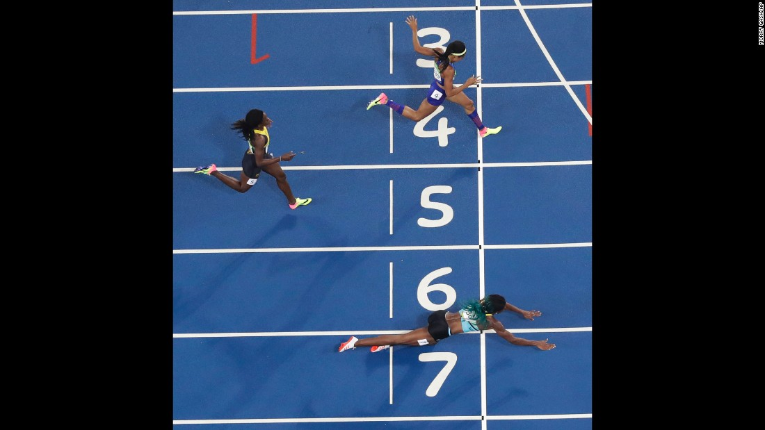 """Shaunae Miller of the Bahamas <a href=""""http://www.cnn.com/2016/08/15/sport/allyson-felix-athletics-olympics/index.html"""" target=""""_blank"""">dives over the finish line</a> to win gold in the 400 meters on Monday, August 15. She edged American Allyson Felix by .07 seconds."""