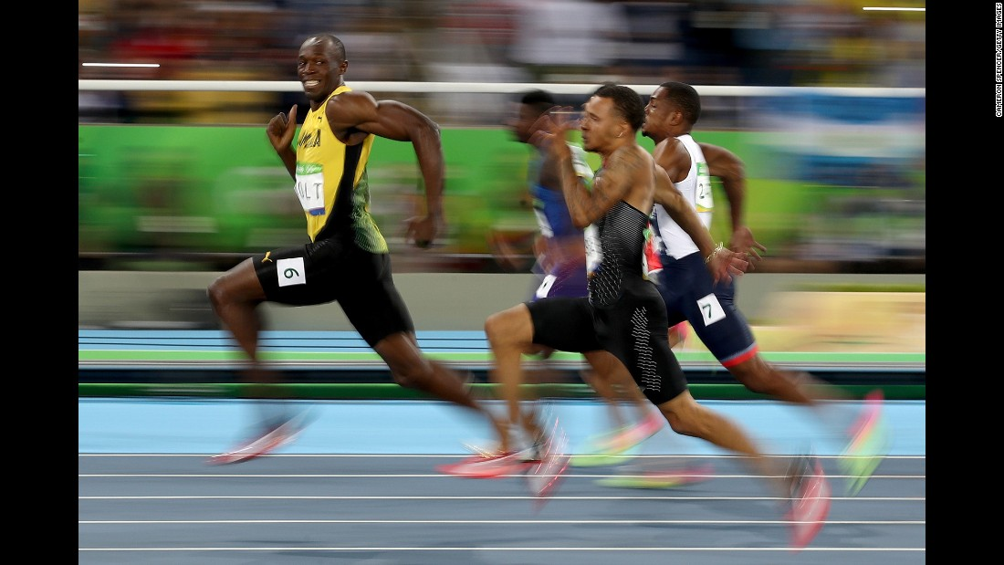 """Jamaican sprinter Usain Bolt looks back at his competitors during a 100-meter semifinal on Sunday, August 14. Bolt <a href=""""http://www.cnn.com/2016/08/14/sport/usain-bolt-justin-gatlin-olympic-games-100-meters-rio/"""" target=""""_blank"""">won the final </a>a short time later, becoming the first man in history to win the 100 meters at three straight Olympic Games."""
