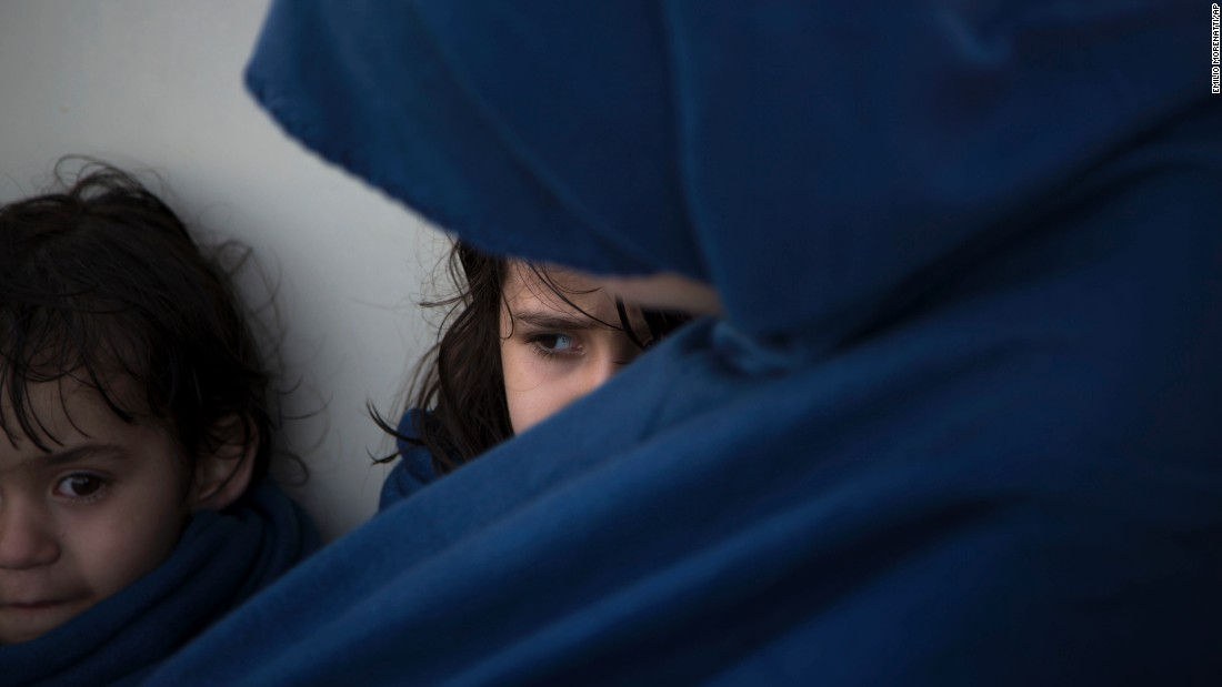 """Osida, 5, sits next to her mother, Aycha, after they were rescued from a sinking boat in the Mediterranean Sea north of Sabratha, Libya, on Thursday, August 18. <a href=""""http://www.cnn.com/2015/09/03/world/gallery/europes-refugee-crisis/index.html"""" target=""""_blank"""">Photos: Europe's migration crisis</a>"""