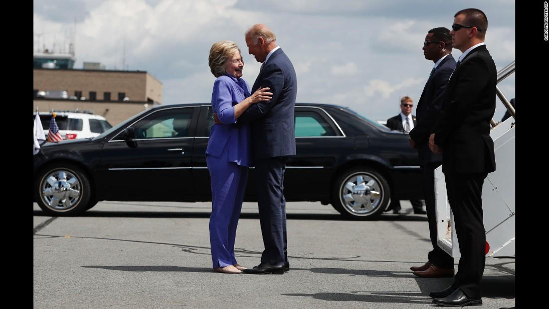 "Democratic presidential nominee Hillary Clinton greets Vice President Joe Biden on an airport tarmac in Avoca, Pennsylvania, on Monday, August 15. <a href=""http://www.cnn.com/videos/us/2016/08/17/joe-biden-endless-hug-moos-pkg-erin.cnn"" target=""_blank"">Watch CNN's Jeanne Moos on the ""endless embrace"" </a>"