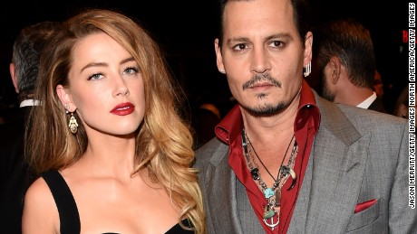 "In this photo from September 14, 2015, Amber Heard and Johnny Depp are seen attending the ""Black Mass"" premiere during the 2015 Toronto International Film Festival in Toronto, Canada."