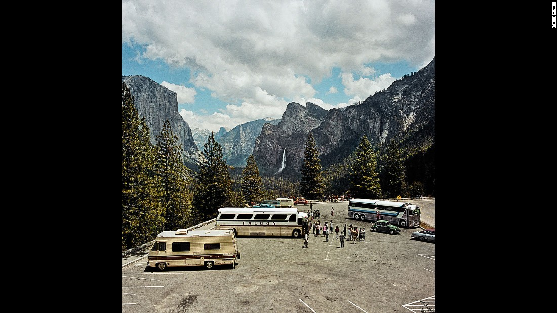 <em>Parking Lot at Inspiration Point, Yosemite National Park, California, 1980. </em>The trappings of tourism -- tour buses, motor homes, casual dress -- are part of what drew Minick to sightseeing.