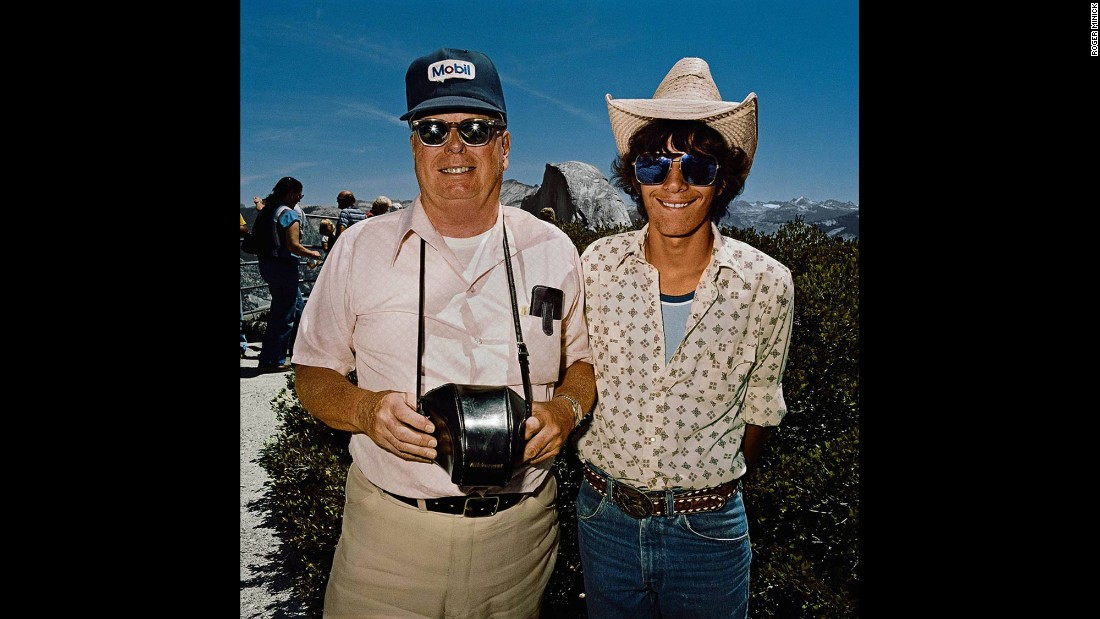 """<em>Father & Son at Glacier Point, Yosemite National Park, California, 1981. </em>Many of Minick's subjects wore clothes that made it easy to """"jump out of the car and take in the view and get back in the car and move on,"""" he said."""