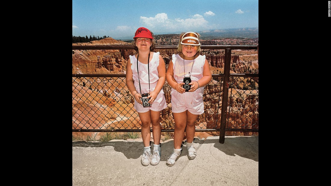 """<em>Girls in Matching Pink Dresses at Sunset Point, Bryce Canyon National Park, 1980. </em>Minick looked for an """"elusive something"""" that made the photos work. This one, he said, """"was just almost too easy."""""""