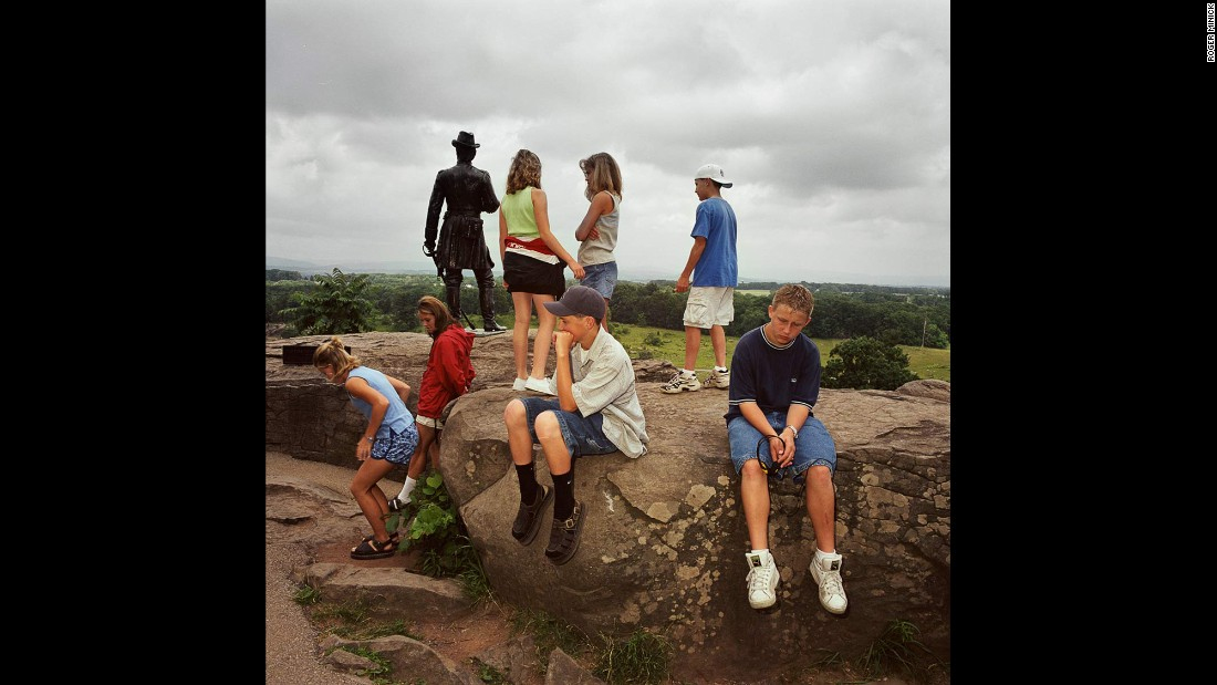 """<em>Gettysburg National Military Park, Pennsylvania, 1999. </em>Minick wasn't sure about this shot, but """"it became kind of interesting when the figures kind of blend in with the statue, and then the kid (at right) ... he kind of does make it work somehow."""""""