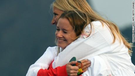 Gold medallists Britain's Hannah Mills and Saskia Clark celebrate on the podium at Rio 2016.