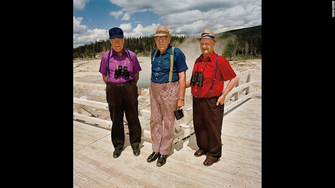 """<em>Three Men in Color Coordinated Shirts at Upper Geyser Basin, Yellowstone National Park, Wyoming, 1980.</em> Minick spotted these men from a distance. """"I saw those three spots of color and I said, 'Oh my God, that's too good.'"""""""