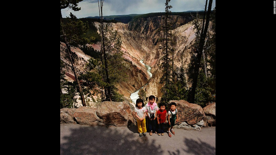 <em>Children at Grand Canyon of the Yellowstone, Yellowstone National Park, Wyoming, 1980. </em>Minick had to work quickly to get his shot before subjects moved on to their next stop.