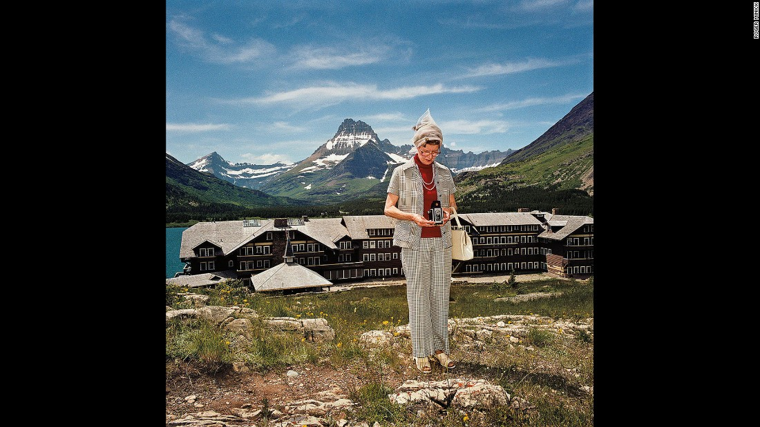 """<em>Woman Taking Photograph at Many Glacier Hotel, Glacier National Park, Montana, 1981. </em>Some of the subjects' wardrobe choices were questionable. Not this """"very classy lady."""""""