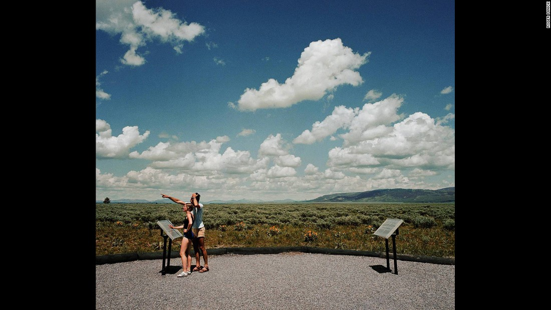 <em>Couple Viewing Grand Tetons, Grand Tetons National Park, Wyoming, 1980. </em>Despite the hot, tired business of tourism, Minick said most of the people he encountered were genuinely awe-struck.
